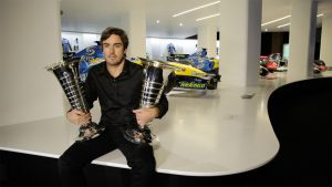 Alonso holding his two F1 world championship trophies