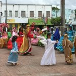 School children dancing in their colourful costumes
