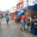 Walking around market place in the rain