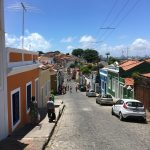 Walking down the hill, with pretty coloured houses