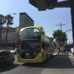 Yellow hop on and off bus