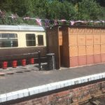 At station with old toilets, milk churns and fire buckets