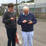 Russell helping Geoff with a new App!