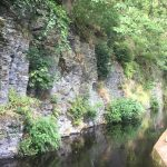Narrow canal cut out of the rock.
