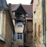 Many unusual buildings in tiny streets